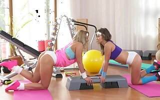 Beautiful girls let someone have their inner passion out to play at the gym