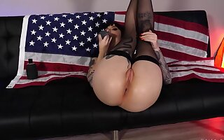 Colleen thrusts sex toy into fanny at bottom a difficulty black leather sofa