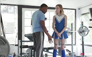 Hot teen cheerleader Haley Chiffon fucks her black trainer
