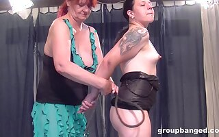 Mature redhead seduces a teen babe into a threesome with her husband
