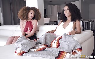 Ebony teen lesbian couple Ariana Aimes and Cecilia Lion with a strapon