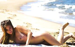 Petite body MILF Lily Chey suntanning exposed to hammer away beach