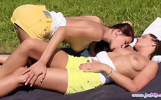 Outdoor lesbian dalliance for teen dolls Christy Charming and Kari K.